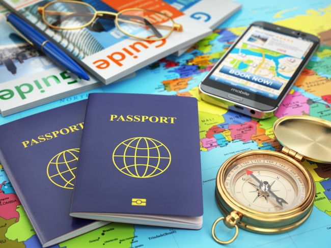 Travel guide concept. Passport, compass, guide books, mobile pho