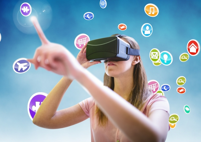Woman using virtual reality headset with digitally generated ico